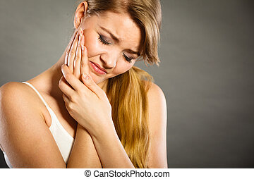 Woman suffering from tooth pain - Dental care and toothache....