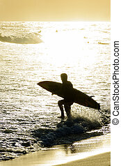 Surf at sunset at Ipanema - Summer sunset with surfers at...