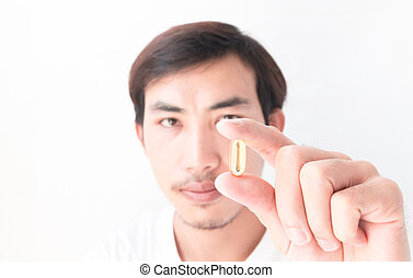 Closeup man hand holding fish oil medicine with white...