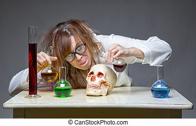 Mixing liquid scientist with human skull on gray background