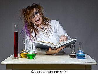 Reading laughing scientist with glass flask on gray...