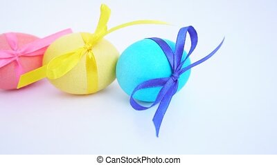 colored Easter eggs with ribbons