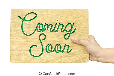 Hand holding wood plate with Coming soon word isolated on white background, Shop sign design, Clipping path on object