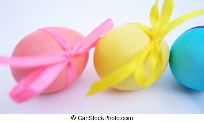 colored Easter eggs with ribbons - Easter colored eggs with...