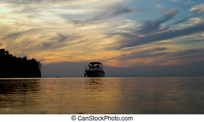 Large Luxury Yacht silhouette at sunset on ocean. Beautiful...