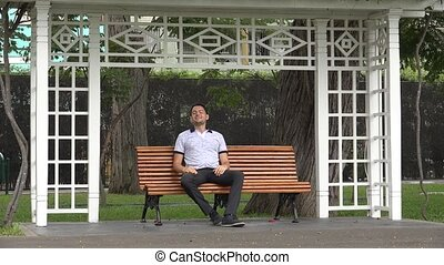 Happy Man Alone Sitting On Park Bench