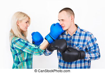 Studio shot of a beautiful funny couple expressive fighting....