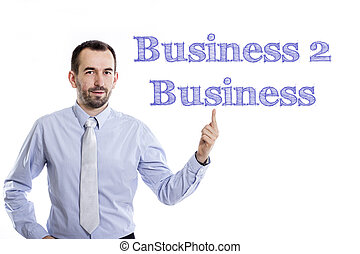Business 2 Business - Young businessman with small beard pointing up in blue shirt