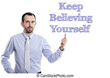 Keep Believing Yourself - Young businessman with small beard pointing up in blue shirt