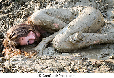 Naked girl lying in the dirt In uterine position