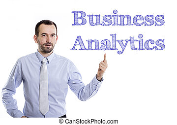 Business Analytics - Young businessman with small beard...