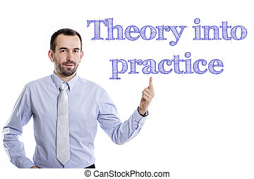 Theory into practice - Young businessman with small beard pointing up in blue shirt