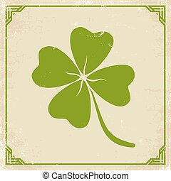 Green clover on old paper.