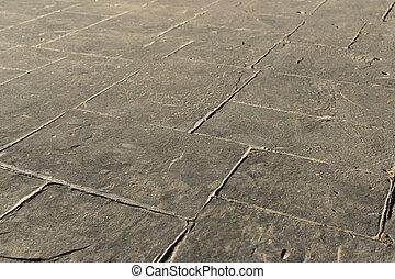 Stamped concrete pavement outdoor, mimics cobblestones...
