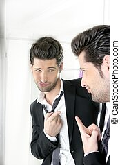 Handsome man humor funny gesture in a mirror - Handsome suit...