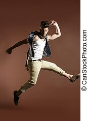 High jump fly young handsome fashion man - High jumping fly...