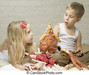 Little boy and girl playing with stuffed animals