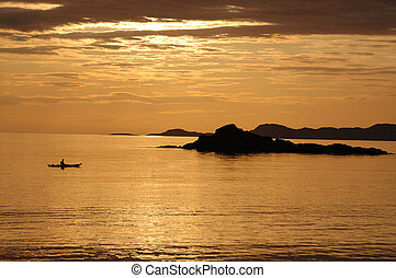 Canoe sunset at Arisaig - A lone canoeist at sunset from the...