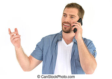 Portrait of a handsome young man talking on the phone on a...
