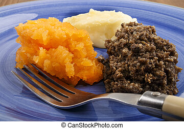 homemade haggis with mashed potato and turnip - typical...
