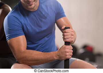 young man after workout with hammer and tractor tire