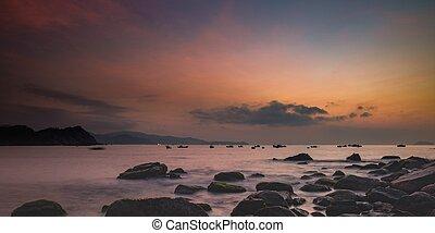 Morning Skyline Vietnam - A fiery orange morning sky looking...