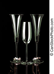Three champagne glasses on black - three green decorated...