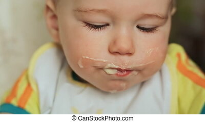 Mother feeds her capricious child. The child refuses to eat...