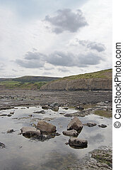 Rock pool Robin Hoods Bay - Sky reflected in a rock pool on...