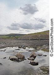 Rock pool Robin Hoods Bay - Sky reflected in a rock pool on...