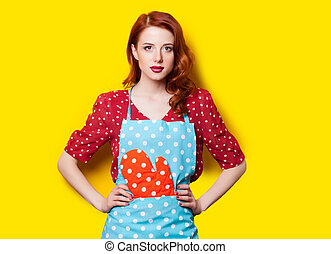 beautiful young woman in pinafore with potholder on the...