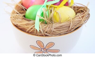 The female lays the egg in a bowl, Easter - The female lays...