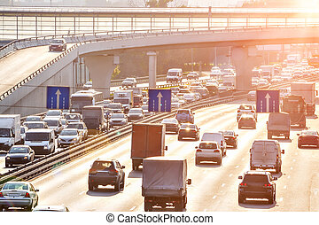 Traffic on the highway - Heavy traffic on the highway with...