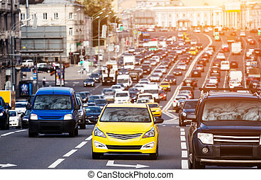 Yellow taxi on the traffic jam - Heavy traffic on the city...