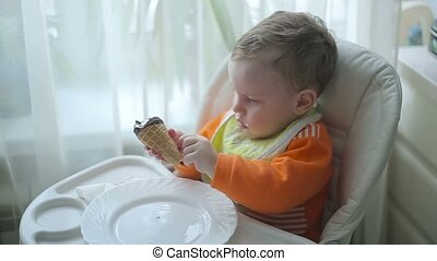 The little boy is eating ice cream