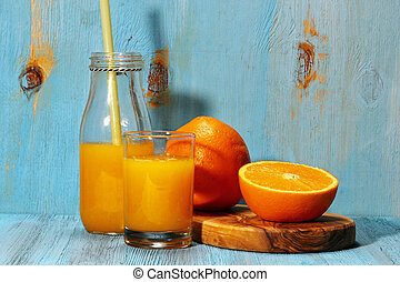 Orange juice in summer - Orange juice with cut up oranges on...