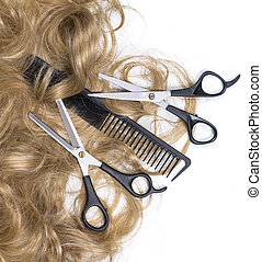Hairdressing scissors with blonde hai