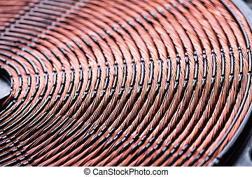 Induction heater copper coil closeup. Electric wires macro...