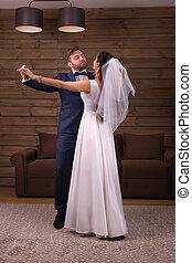 Newlyweds couple dancing wedding dance - Romantic newlyweds...