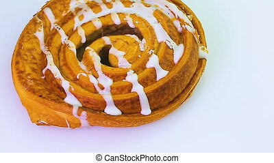Buns with raisins rotates on a white background. Video full...