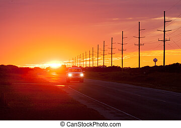 Sunset highway traffic Hatteras Island OBX NC US