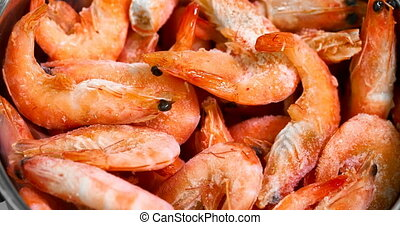 Cooking shrimp in a pan close up video.