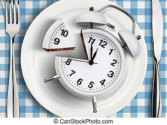 Time to meal concept, cut clock on plate. top view - Time to...