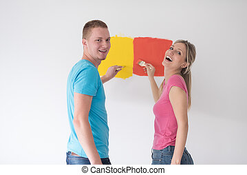couple painting interior wall