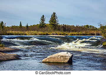 Foam water rapids in Old Pinawa Dam - Foam water rapids on...