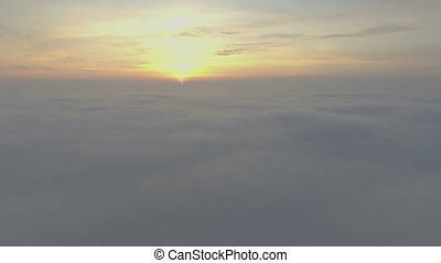 Scenic flight above the clouds towards the sun. - Scenic...