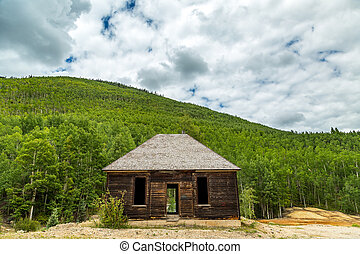 Abandoned Mountain Cabin - An abandoned cabin sits alongside...