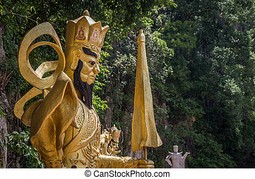 Gold buddhist sacred staue at temple in Ipoh, Malaysia