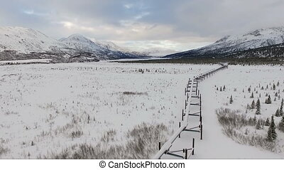 Oil Transport Alaska Pipeline Cuts Across Rugged Mountain...