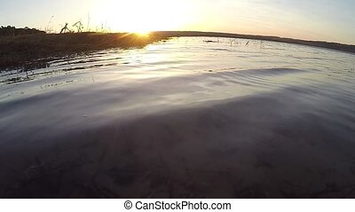 Lake and sunset waves calm water the landscape beautiful -...